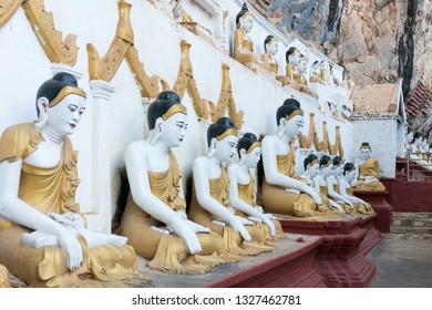 HPA-AN, MYANMAR - 19 NOVEMBER, 2018: Horizontal picture of  Buddha statues sitting in meditation at Kaw Goon Cave, important landmark of Hpa-An, Myanmar