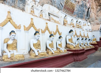 HPA-AN, MYANMAR - 19 NOVEMBER, 2018: Wide angle picture of  Buddha statues sitting in meditation at Kaw Goon Cave, important landmark of Hpa-An, Myanmar
