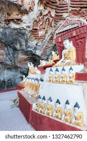 HPA-AN, MYANMAR - 19 NOVEMBER, 2018: Vertical picture of a plenty of Buddha statues at Kaw Goon Cave in Hpa-An, Myanmar