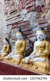 HPA-AN, MYANMAR - 19 NOVEMBER, 2018: Vertical picture of amazing Buddha statues with decorated walls at Kaw Goon Cave in Hpa-An, Myanmar
