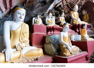 HPA-AN, MYANMAR - 19 NOVEMBER, 2018: Wide angle picture of beautiful Buddha statues in the interior of Kaw Goon Cave, landmark of Hpa-An, Myanmar