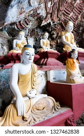 HPA-AN, MYANMAR - 19 NOVEMBER, 2018: Vertical picture of beautiful Buddha statues in the interior of Kaw Goon Cave, landmark of Hpa-An, Myanmar