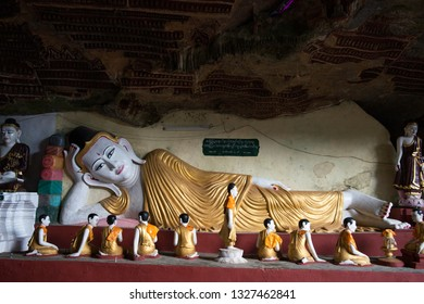 HPA-AN, MYANMAR - 19 NOVEMBER, 2018: Horizontal picture of reclined Buddha statue in the interior of Kaw Goon Cave, landmark of Hpa-An, Myanmar