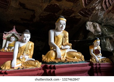 HPA-AN, MYANMAR - 19 NOVEMBER, 2018: Horizontal picture of beautiful Buddha statues in the interior of Kaw Goon Cave, landmark of Hpa-An, Myanmar