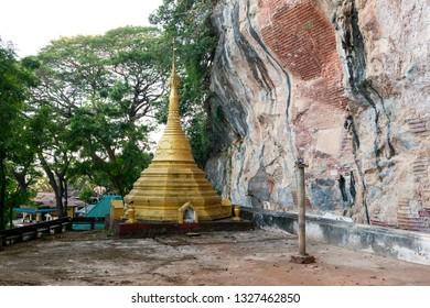 HPA-AN, MYANMAR - 19 NOVEMBER, 2018: Horizontal picture of beautiful pagoda at Kaw Goon Cave, landmark of Hpa-An, Myanmar