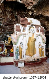 HPA-AN, MYANMAR - 19 NOVEMBER, 2018: From the top picture of huge golden statue at Kaw Goon Cave, landmark of Hpa-An, Myanmar