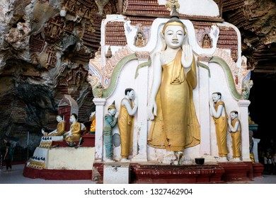 HPA-AN, MYANMAR - 19 NOVEMBER, 2018: Horizontal picture of huge golden statue at Kaw Goon Cave, landmark of Hpa-An, Myanmar