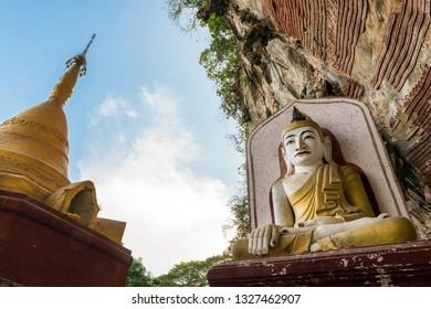 HPA-AN, MYANMAR - 19 NOVEMBER, 2018: Wide angle picture of golden pagoda and huge Buddha statue at Kaw Goon Cave in Hpa-An, Myanmar