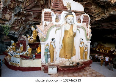 HPA-AN, MYANMAR - 19 NOVEMBER, 2018: Wide angle picture of huge golden statue at Kaw Goon Cave, landmark of Hpa-An, Myanmar