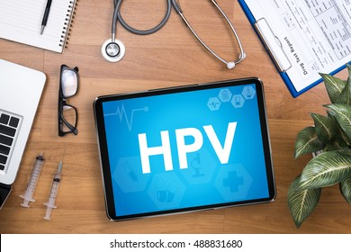HPV CONCEPT Professional doctor use computer and medical equipment all around, desktop top view