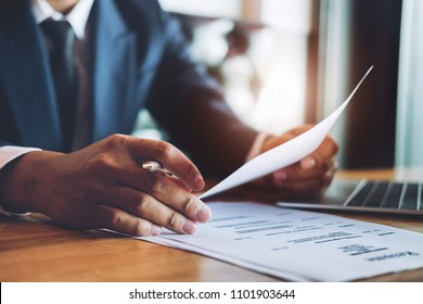 hr audit resume applicant paper and interview with using pen and computer laptop for selection human resource to company.