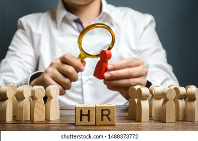 The HR examines a candidate red figure. Recruiting new workers, headhunters Human resources. Search for talented worker. Assessment of qualities skills. Attraction of valuable personnel to the company