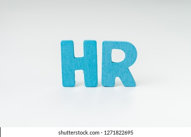 HR, Human Resource department, hiring new job or position in company concept, miniature people uniform worker team help building wooden alphabet the word HR at the center with white background.