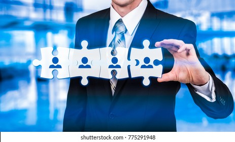 HR - Human Resources - business concept with hand businessman and puzzle.