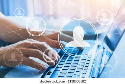 HR, human resources concept, social network with company people icons, online community, hands typing on computer keyboard