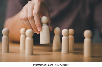 HR manager hand or Employer chooses takes in hand employee. Leader stands out from crowd. Looking for good worker. HR, HRM, HRD concepts