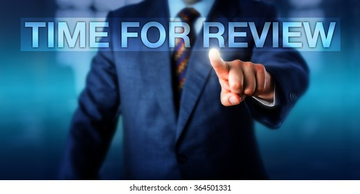 HR manager is pressing TIME FOR REVIEW on a touch screen interface. Business metaphor for performance appraisal, judgmental evaluation, career development discussion and self assessment. Copy space.
