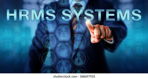 HR manager pushing HRMS SYSTEMS on a touch screen. Female and male white collar worker icons enclosed in hexagons do populate the virtual display. Concept for Human Resource Management Systems.