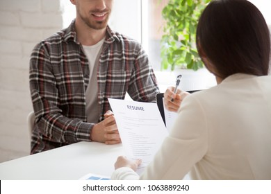 Hr manager reading smiling applicants resume at job interview, recruiter employer holding cv of confident vacancy candidate, good first impression, employment and hiring, staff recruiting concept