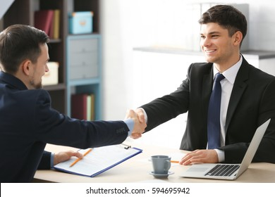 HR manager shaking hands with applicant