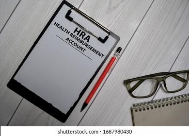 HRA - Health Reimbursement Account write on a paperwork isolated on office desk. - Shutterstock ID 1687980430