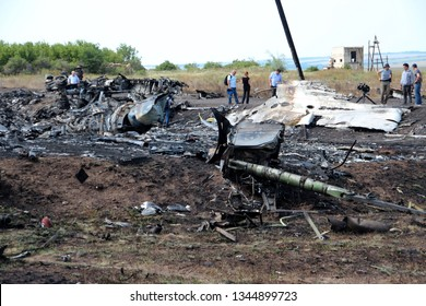 Hrabovo, Donetsk region / Ukraine - 07.25.2014   OSCE inspectors visiting crash site of the Boeing-777 of Malaysia airlines, flight MH17 near Hrabovo village. Burnt wreckage of the plane.