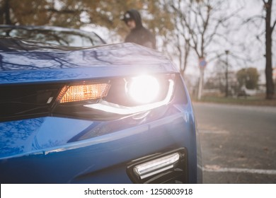HRADEC KRÁLOVÉ, CZECH REPUBLIC - DECEMBER 6, 2018: Man with snapback standing next to Clean Chevrolet Camaro SS 2018 in outdoor after car detailing