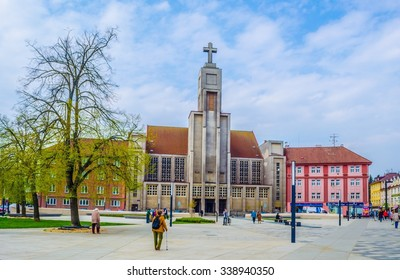 HRADEC KRALOVE, CZECH REPUBLIC, APRIL 30, 2015: people are passing by in front of the modern looking church of divine heart of lord (bozskeho srdce pane)