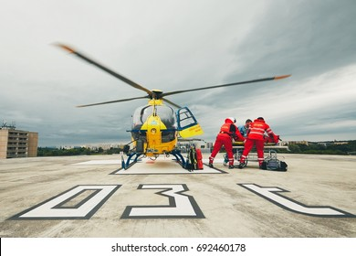 HRADEC KRALOVE, CZECH REPUBLIC - JUNE 17, 2017: Team of the Helicopter Emergency Medical Service passes the patient to the Emergency on the roof University Hospital in Hradec Kralove on June 17, 2017.