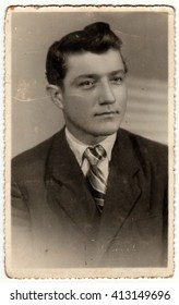 HRADEC KRALOVE, THE CZECHOSLOVAK SOCIALIST REPUBLIC - CIRCA 1950s: The vintage photo shows young man. The studio photography was taken for A level (GCSE exam) occasion.