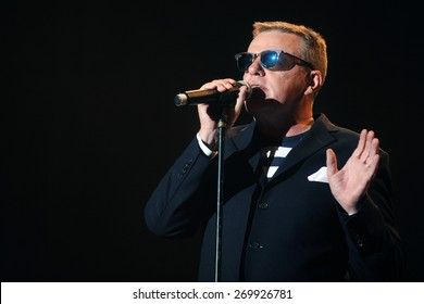 HRADEC KRALOVE - JULY 4: Singer Graham McPherson alias Suggs of famous British band Madness during performance at festival Rock for People in Hradec Kralove, Czech republic, July 4, 2014.