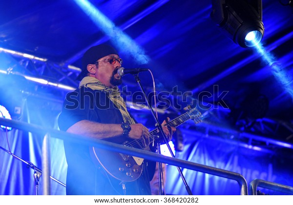 HRADEC KRALOVE - JULY 4: U.S. movie star Steven Seagal performs during the music festival Rock for People in Hradec Kralove, the Czech Republic, on Friday, early morning, July 4, 2014.