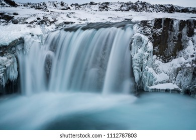 Hranabjargafoss waterfall surrounded by ice and snow during wint