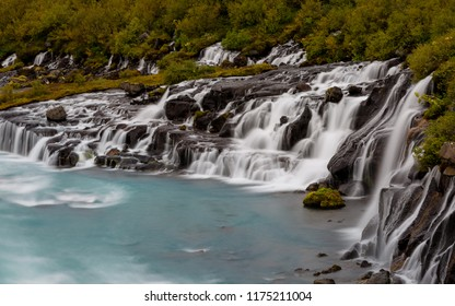 Hraunfossar Barnafoss waterfall Iceland, a series of waterfalls formed by rivulets streaming over a distance of about 900 metres out of the Hallmundarhraun lava field