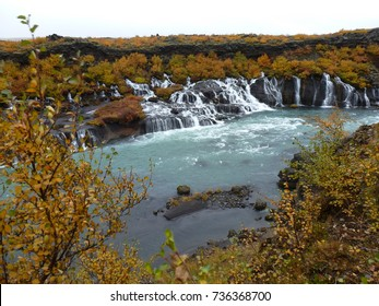 Hraunfossar a beautiful water fall in the west of Iceland in autumn, beautiful colors