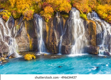 Hraunfossar (Borgarfjordur, western Iceland) waterfalls formed by rivulets streaming out of the Hallmundarhraun lava field formed by the eruption of a volcano lying under the glacier Langjokul.