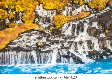 Hraunfossar (Borgarfjordur, western Iceland) waterfalls formed by rivulets streaming out of the Hallmundarhraun lava field created by the eruption of a volcano under the glacier Langjokull.