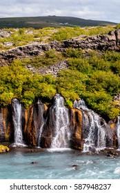 Hraunfossar (Borgarfjordur, western Iceland) waterfalls streaming out of the Hallmundarhraun lava field created by the eruption of a volcano under the glacier Langjokull into Hvita river.