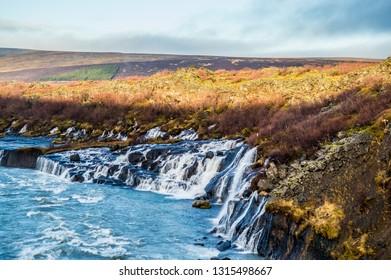 Hraunfossar Husafell waterfall Iceland, during golden hour