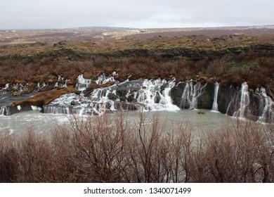 Hraunfossar, Iceland on 23.02.2019: Hraunfossar waterfalls in winter