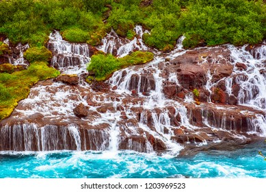 Hraunfossar series of waterfalls formed by rivulets streaming over a distance of about 900 metres. Iceland travel destination