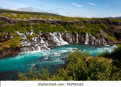 Hraunfossar series of waterfalls formed by rivulets streaming over a distance of about 900 metres