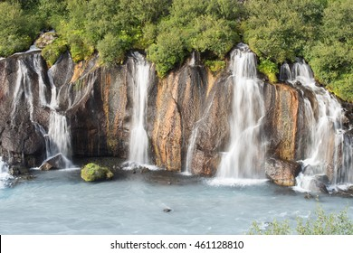 Hraunfossar, a series of waterfalls formed underground water flowing under a lava field. Western Iceland