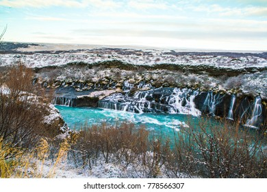 Hraunfossar, a waterfall formed by rivulets streaming over Hallmundarhraun, a lava field from volcano lying under the glacier Langjokull, and pour into the Hvita river, Iceland