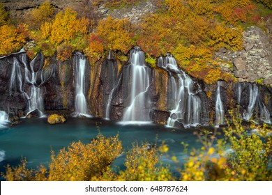 Hraunfossar waterfall in Iceland. Autumn colorful landscape