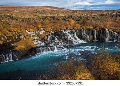 Hraunfossar waterfall, Iceland. Autumn landscape. Husafell