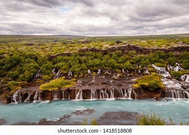 Hraunfossar waterfall streams falling into Hvita river, Husafell, Western Iceland