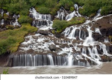 Hraunfossar waterfall (Western Iceland) Hraunfossar waterfall's water is falling into Hvita river