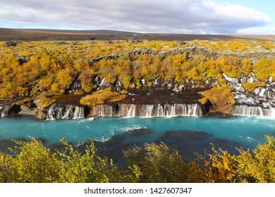 Hraunfossar waterfalls - one of the most beautiful waterfalls in Iceland. Hraunfossar is a series of waterfalls runs out of the Hallmundarhrau lava field into the Hvita river.