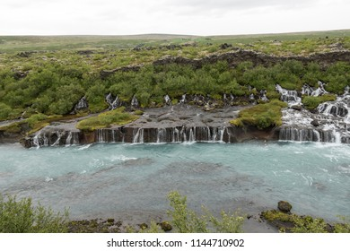 Hraunfossar (Borgarfjörður, western Iceland), a series of waterfalls that pour into the Hvítá river